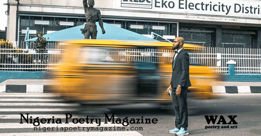 Images shows a man standing on the street while a yellow van streaks behind him - Nigeria Poetry Magazine - nigeriapoetrymagazine.com