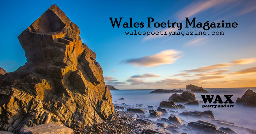 Image shows a timelapse photo of a rocky seaside at sunset - Wales Poetry Magazine - walespoetrymagazine.com